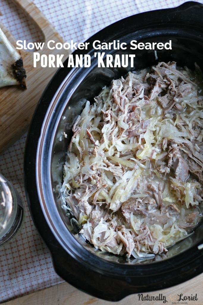 Break out the slow cooker! This garlic seared pork and kraut recipe is seriously one that will please the whole family. Plus, it's rich with probiotics!