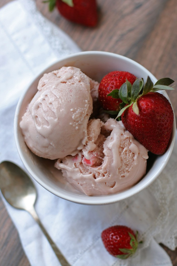 Enjoy this flavorful and creamy homemade dairy-free strawberry ice cream made with simple ingredients like maple syrup, coconut milk, vanilla, and pastured eggs.